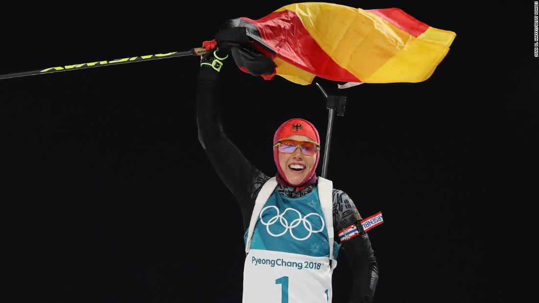 Germany's Laura Dahlmeier celebrates after winning her second biathlon event of these Olympics. She is also the first woman to win a pursuit and a sprint at the same Olympics.