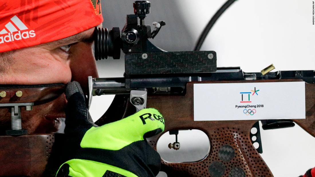 German biathlete Arnd Peiffer aims his rifle during the 12.5-kilometer pursuit.