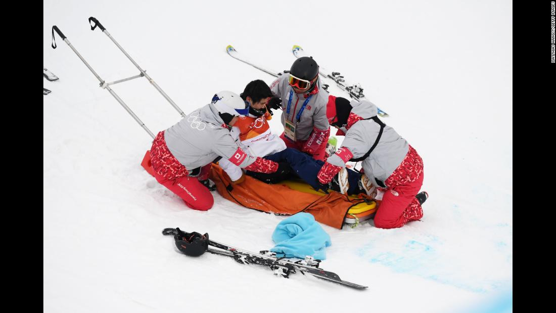 Medical staff attend to Japan's Yuto Totsuka after he crashed during the halfpipe final. He was taken to the hospital.