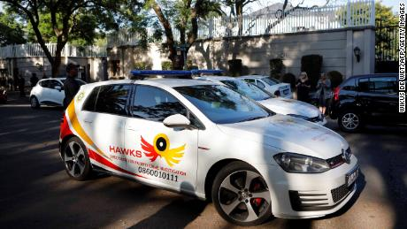 A patrol car belonging to the Hawks, The Directorate for Priority Crime Investigation, is seen outside the compound of the Gupta business.