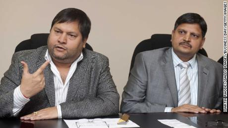 Indian businessmen, Ajay Gupta (R) and younger brother Atul Gupta pictured in March 2011.