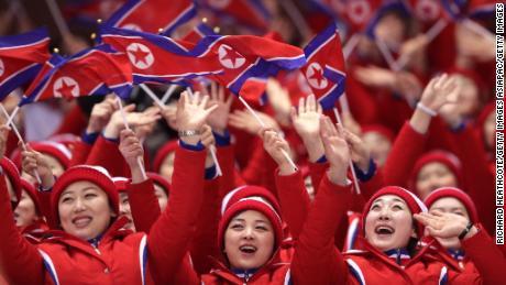 North Korean cheerleaders wave flags during the pair skating short program.