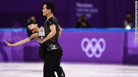 North Korea's Ryom Tae Ok (L) and North Korea's Kim Ju Sik competed in the pair skating short program event.