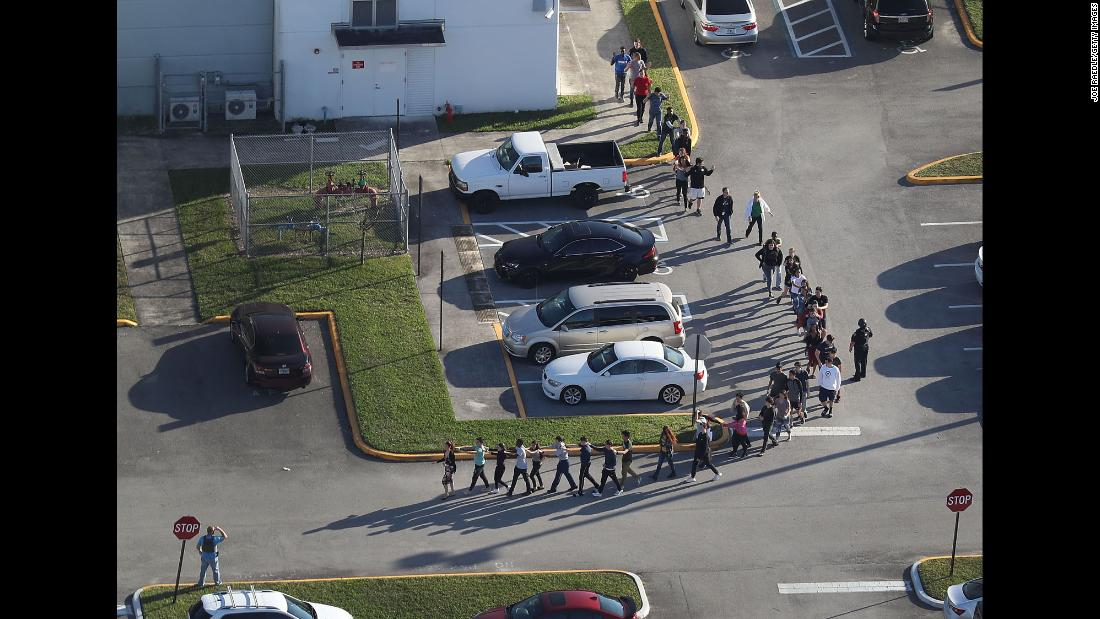 Armed sheriff's deputy stayed outside Florida school while massacre took place