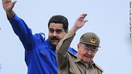 Cuban President Raul Castro (R) and his Venezuelan counterpart Ricardo Maduro (L) participate in the May Day celebrations, on May 1, 2015 in Havana.     AFP PHOTO/YAMIL LAGE        (Photo credit should read YAMIL LAGE/AFP/Getty Images)