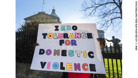 Mandatory Credit: Photo by ERIK S. LESSER/EPA-EFE/REX/Shutterstock (9366139j) A woman holds a protest sign 'Zero Tolerance for Domestic Violence' during an anti-domestic violence rally outside the Georgia State Capitol in Atlanta, Georgia, USA, 08 February 2018. National Taskforce Against Domestic Violence and other Equal Rights Amendment supporters hosted the Georgia ERA Capitol Day event. Anti-domestic violence rally in Atlanta, USA - 08 Feb 2018