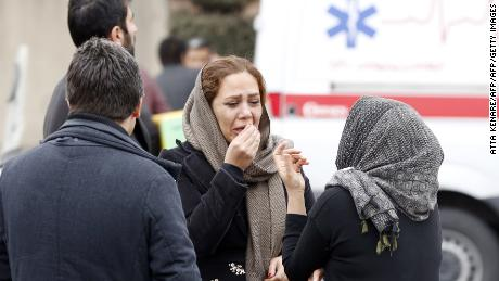 Relatives of Iranian passengers, onboard the Aseman Airlines flight EP3704, react as they gather in front of a mosque near Tehran's Mehrabad airport on February 18, 2018.  All 66 people on board an Iranian passenger plane were feared dead after it crashed into the country's Zagros mountains, with emergency services struggling to locate the wreckage in blizzard conditions.  / AFP PHOTO / ATTA KENARE        (Photo credit should read ATTA KENARE/AFP/Getty Images)