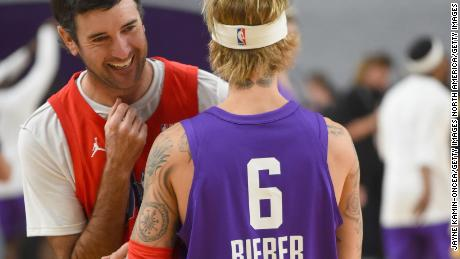Bubba Watson has a laugh with Justin Bieber during warm-up prior to the 2018 NBA All-Star Celebrity Game at Los Angeles Convention Center.