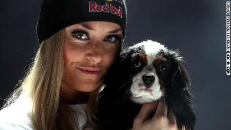 Lindsey Vonn of USA poses with her dog Lucy ahead of the FIS Alpine World Ski Championships on February 5, 2017 in St Moritz, Switzerland