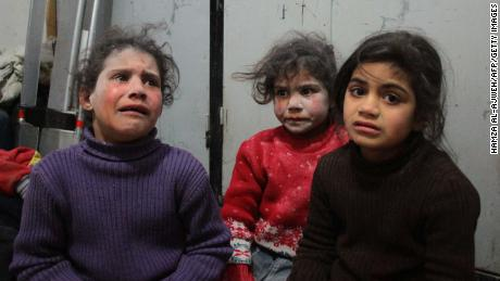 Syrian children at a makeshift hospital in Douma following airstrikes.