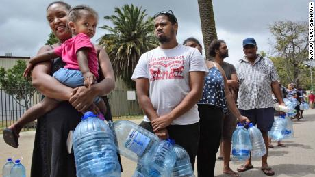 People wait in line for water in Cape Town on Feb. 16, 2018. In June, the South African city is expected to become the first major world city to completely run out of water, according to media reports. (Photo by Kyodo News/Sipa USA)