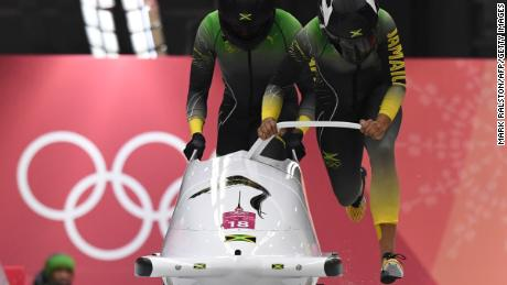 Jamaica's Jazmine Fenlator-Victorian and Jamaica's Carrie Russell compete in the women's bobsleigh heat 1 run during the Pyeongchang 2018 Winter Olympic Games, at the Olympic Sliding Centre on February 20, 2018 in Pyeongchang.