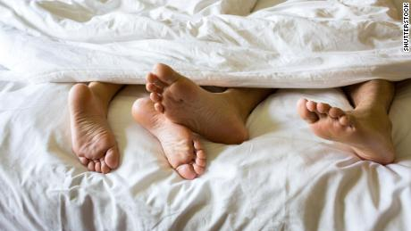Get better sleep by cuddling up with your partner