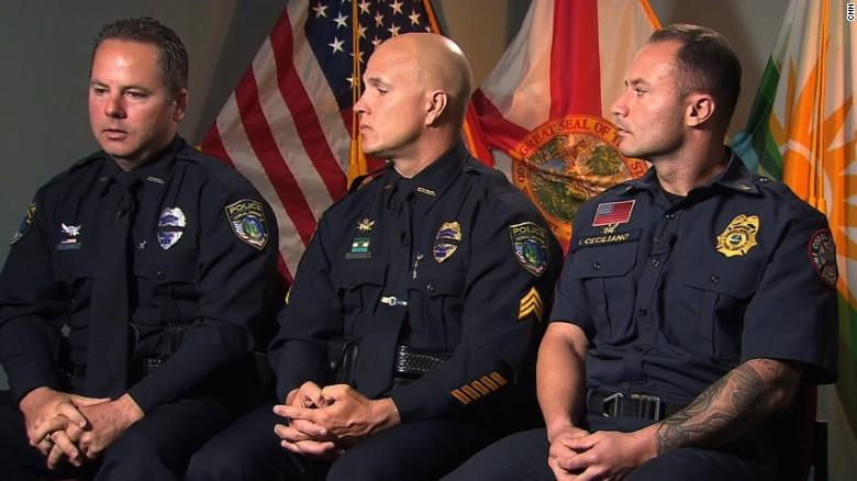 Florida officer who didn't enter school during shooting now has armed guards