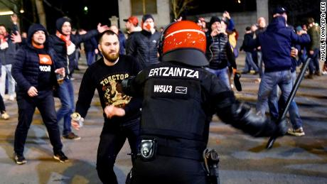 Police officers clash with supporters during riots prior to the UEFA Europa League round of 32, second leg soccer match between Athletic Bilbao and Spartak Moscow.