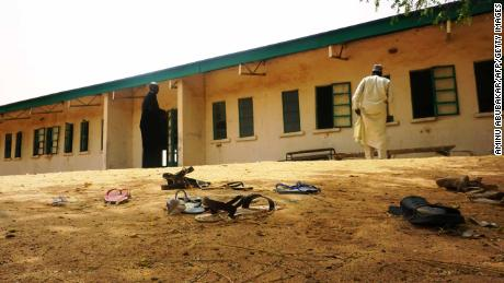 Sandals sit outside the school after the girls fled Boko Haram militants.