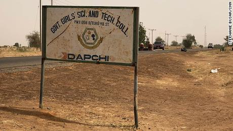 A dusty sign along the road to the school on Dapchi's outskirts.