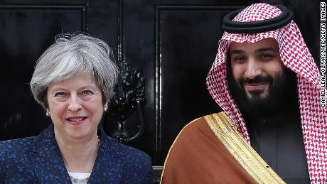 Britain's Prime Minister Theresa May greets Saudi Arabia's Crown Prince Mohammed bin Salman outside 10 Downing Street on March 7, 2018.