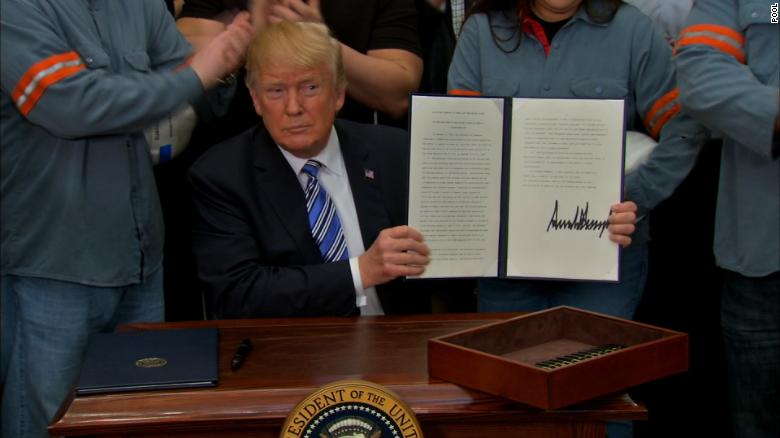 Trump signs orders imposing stiff tariffs on steel, aluminum