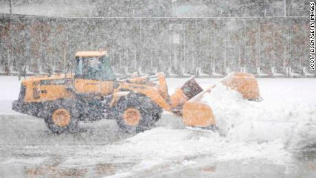 BOSTON, MA - MARCH 13:  A snow plow clears snow on a taxiway at Logan International Airport as Winter Storm Skylar bears down on March 13, 2018 in Boston, Massachusetts.  (Photo by Scott Eisen/Getty Images)