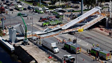 Emergency personnel respond after a brand-new pedestrian bridge collapsed onto a highway at Florida International University in Miami on Thursday, March 15, 2018. The pedestrian bridge collapsed onto the highway crushing multiple vehicles and killing several people. (Pedro Portal/Miami Herald via AP)