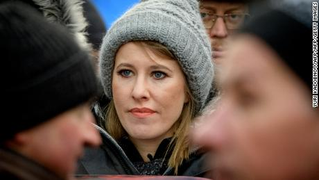 Russian TV journalist and presidential candidate Ksenia Sobchak (C) stands during an opposition march in memory of murdered Kremlin critic Boris Nemtsov in central Moscow on February 25, 2018.  The 55-year-old former first deputy prime minister under Boris Yeltsin was shot in the back several times just before midnight on February 27, 2015 as he walked across a bridge a stone's throw from the Kremlin walls. / AFP PHOTO / Yuri KADOBNOV        (Photo credit should read YURI KADOBNOV/AFP/Getty Images)