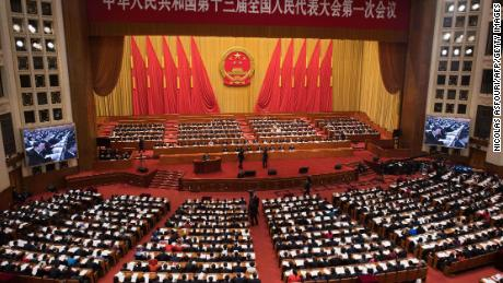 A general view shows the fourth plenary session of the National People's Congress (NPC) with China's President Xi Jinping (centre, 2nd row from front) at the Great Hall of the People in Beijing on March 13, 2018. China's rubber-stamp parliament on March 11 endorsed Xi's move to abolish rules limiting heads of state to 10 years in power. / AFP PHOTO / NICOLAS ASFOURI        (Photo credit should read NICOLAS ASFOURI/AFP/Getty Images)