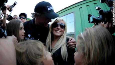 Mickelson embraces wife Amy and shares his 2010 Masters win with his three kids.
