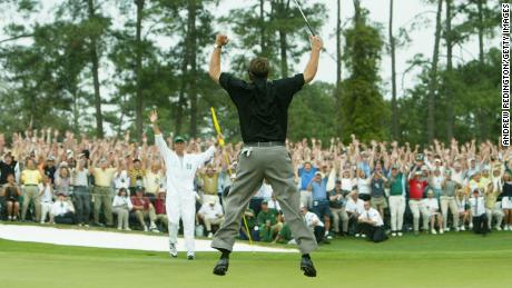 Mickelson reaches for the sky after winning his first major at the 2004 Masters.