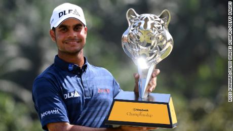 Sharma poses with the Maybank Championship trophy in February 2018.