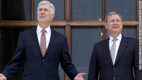 WASHINGTON DC- JUNE 15 Supreme Court Justice Neil Gorsuch talks with Chief Justice John Roberts on the steps of the Supreme Court following his official investiture at the Supreme Court