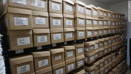 Neatly labeled boxes in the unidentified remains closet in forensic anthropologist Kate Spradley's lab in San Marcos, Texas.
