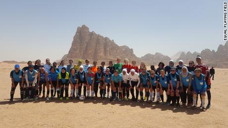 Group shot in Wadi Rum in the desert.