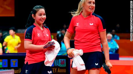 Eleven-year-old table tennis player Anna Hursey of Wales (L) celebrates with teammate Charlotte Carey (R) after winning their women's doubles match against India.