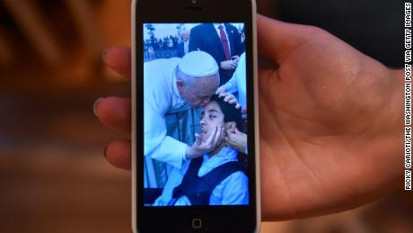 A video of Pope Francis kissing Michael Keating  quickly went viral and inspired others.