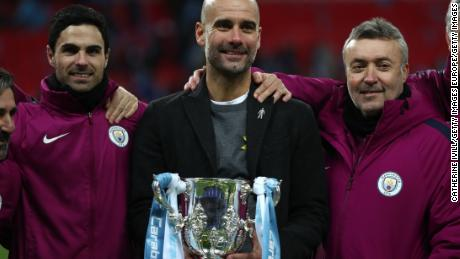 Guardiola and his staff celebrate after winning the Carabao Cup Final against Arsenal.