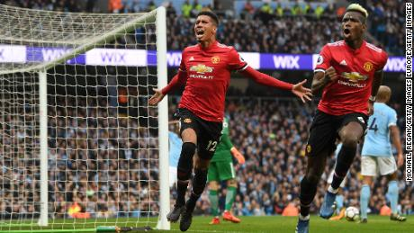 Chris Smalling celebrates scoring Manchester United's third goal with Paul Pogba.