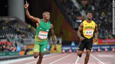 South Africa's Akani Simbine crosses the finish line to claim victory in the men's 100m final at the Commonwealth Games.