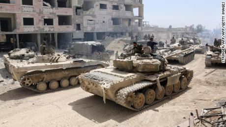 Syrian tanks assemble on the outskirts of Douma on Sunday in an operation to retake Eastern Ghouta