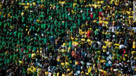 Mourners pack the stands at  Soweto's Orlando stadium for Saturday's funeral.