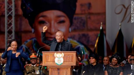 Winnie Madikizela-Mandela's image serves as a backdrop at her funeral Saturday at Orlando Stadium in Soweto, as Julius Malema, leader of the Economic Freedom Fighters populist opposition party, pays tribute to her.