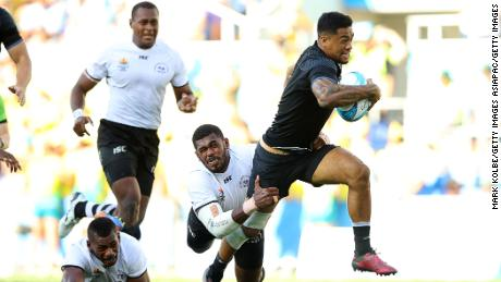 Regan Ware breaks through a Fijian tackle to score New Zealand's second try of the final.