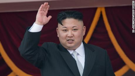 North Korean leader Kim Jong-Un waves from a balcony of the Grand People's Study house following a military parade marking the 105th anniversary of the birth of late North Korean leader Kim Il-Sung, in Pyongyang on April 15, 2017. 