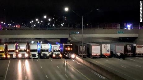 Detroit truckers line up under a freeway overpass to help a suicidal man.