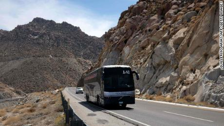 A bus carrying migrants on the road of La Rumorosa, in Tecate, Baja California state.