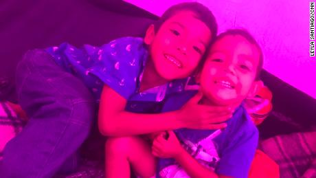 The boys play inside their fuchsia tent, a little space of their own for a while.