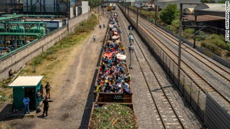 "Migrants clamber onto trains they nickname ""The Beast"" to head north."