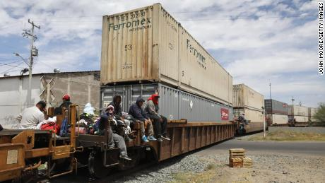 Migrants find what space they can on freight trains.