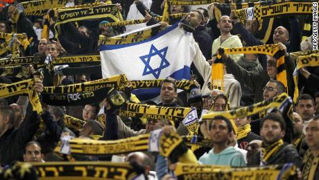 Beitar Jerusalem's supporters chant during an Israeli league game.