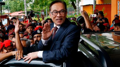 Malaysia's reformist icon Anwar Ibrahim, center, waves to his supporters and journalists after leaving a hospital in Kuala Lumpur,  Wednesday, May 16.